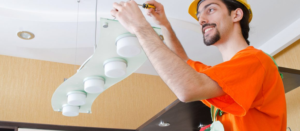 Electrician working on cabling lighting