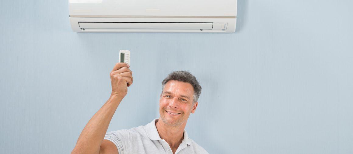 Man Operating Air Conditioner