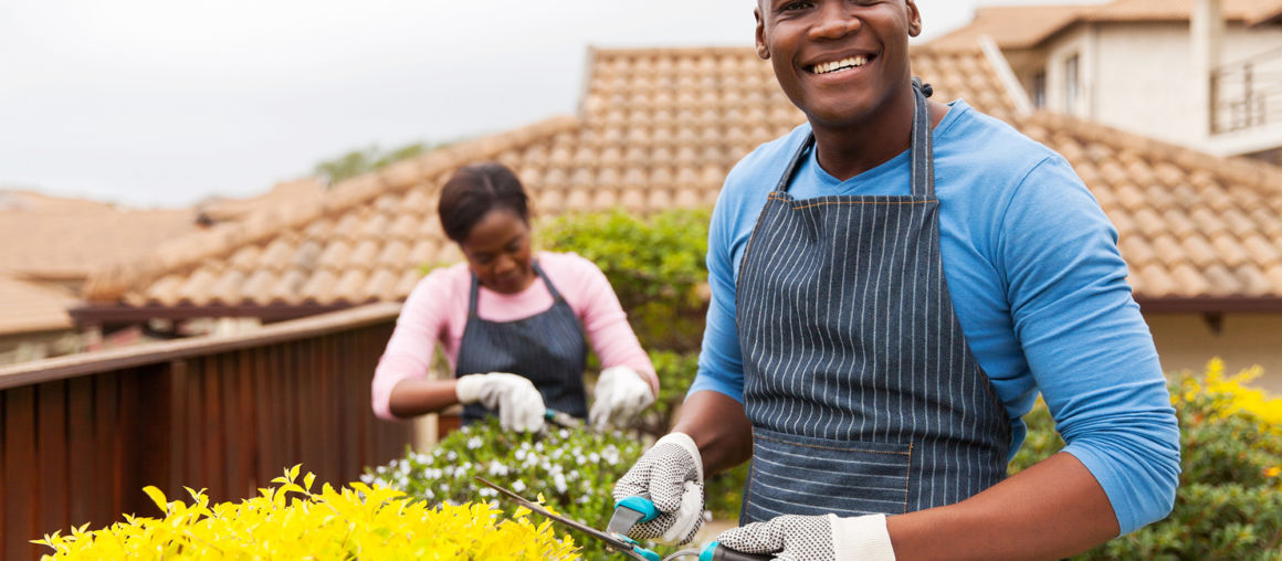 african man gardening with his wife