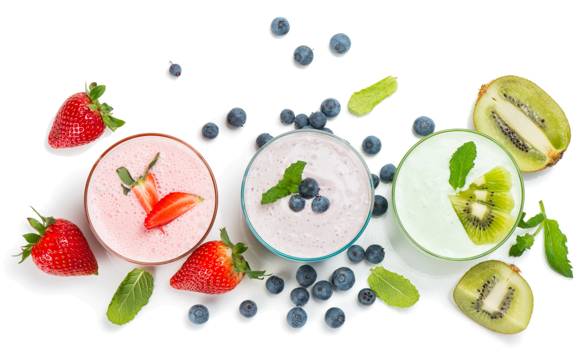Top view of different smoothies of berry isolated on white background