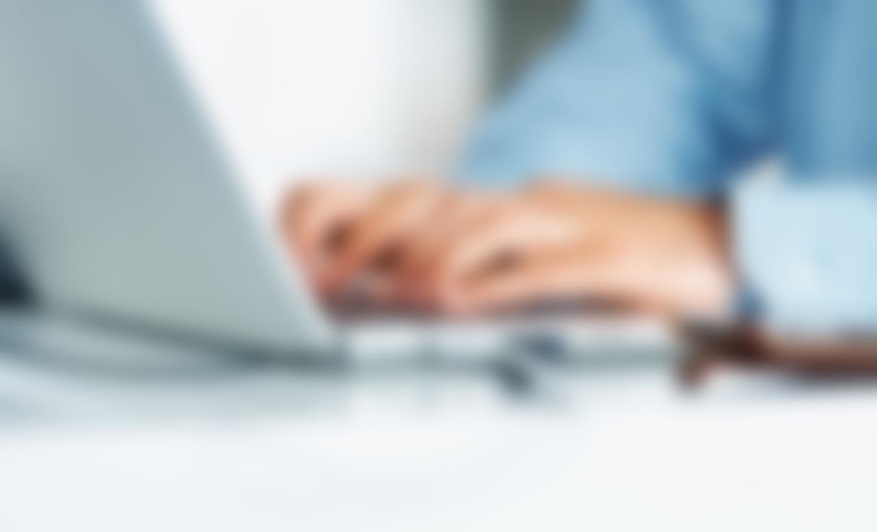 Executive typing on laptop