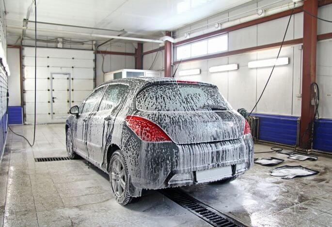 """Wash Me"" Writings on a Car"