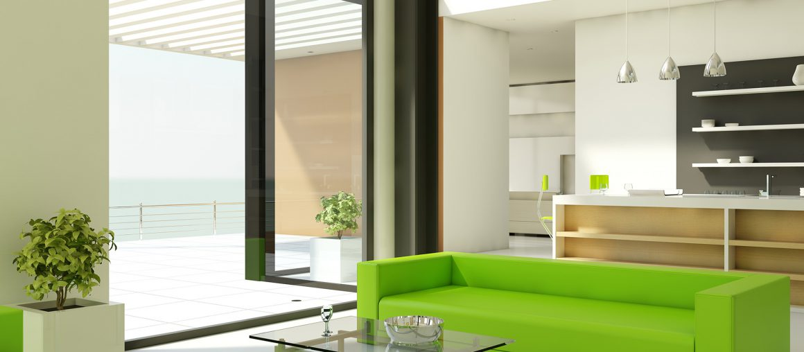 Light interior design with white walls and green couch