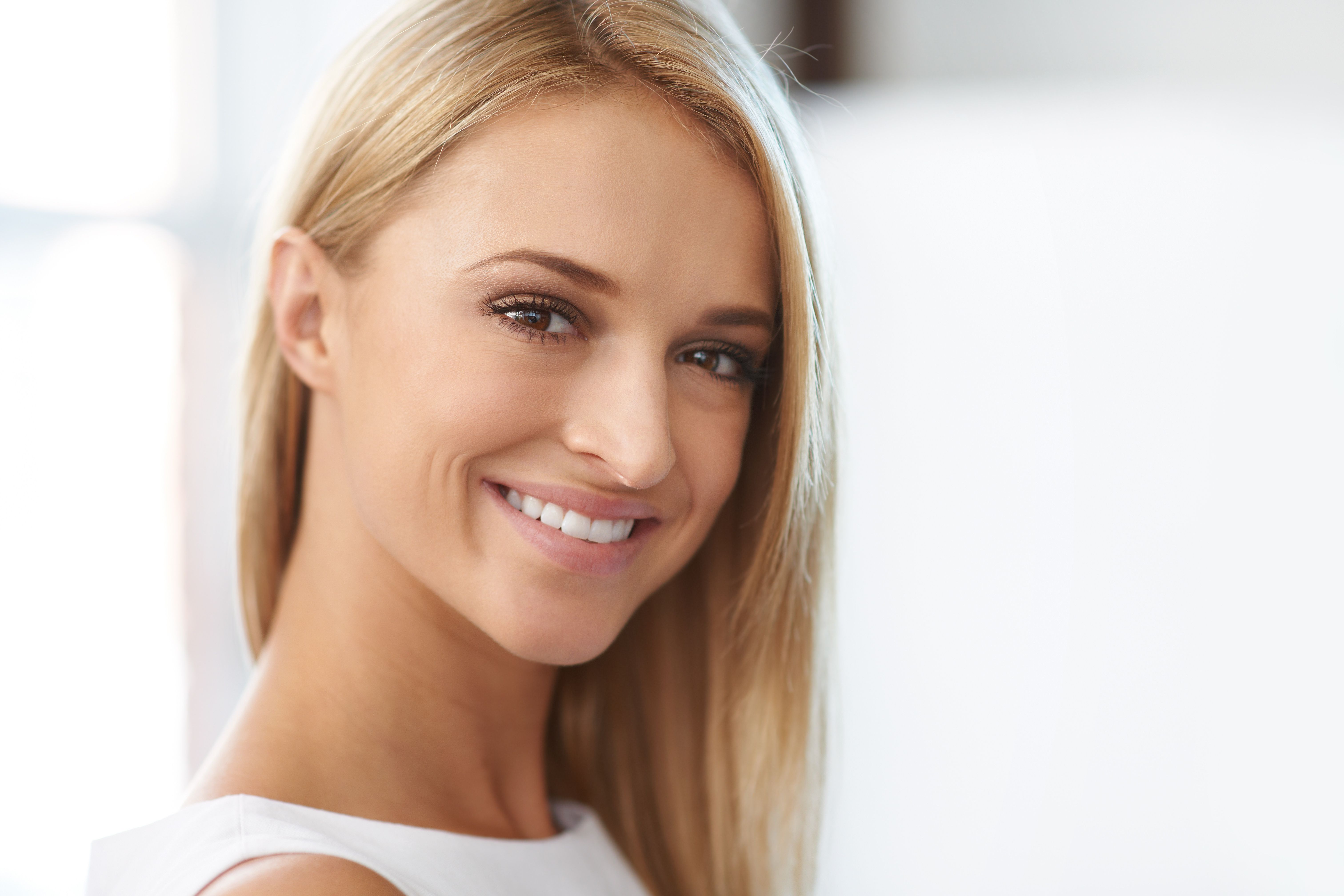 Portrait of smiling beautiful blonde with copyspace
