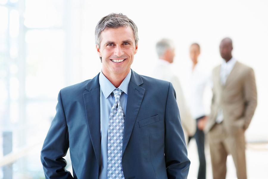 bigstockphoto_A_Handsome_Professor_Smiling_W_4925873